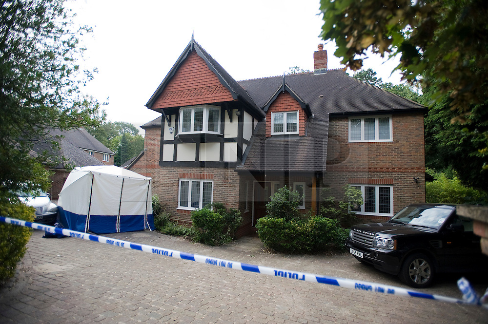 © licensed to London News Pictures.  03/08/2011. Camberley, UK. Police outside a property on Heatherdale Road, Camberley Surrey today (03/08/2011) where the body of a 60 year old man was found yesterday afternoon. His death is believed to have been caused by stab wounds. A man in his 30's has been arrested in connection with the death. Photo credit: Ben Cawthra/LNP