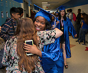 Graduating seniors parade through the halls of  Westbury High School, May 23, 2016.