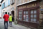 Old post office in Najac, France. Najac is in the Aveyron department in southern France. Najac village is set along a ridge above a bend in the Aveyron River. The village is known for historic buildings and apparent medieval character. In the earlier part of the last century the village had around 2000 people but it suffered marked population decline as workers migrated to towns and cities. Several films concern the village and its surrounds, for example, La Vie Comme Elle Va.
