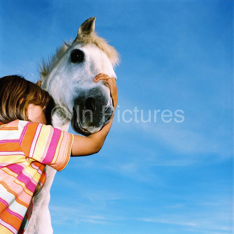 Farmer's daughter Rebecca Hawkins and her horse 'Merry Legs', Warren Farm, Simonsbath, Exmoor, Somerset, UK