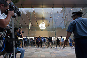 Apple employees welcome customers into the store at 8am on the day of the launch of the iPhone 7 and iPhone 7 plus at the Apple store in Omotesando, Tokyo, Japan. Friday September 16th 2016. The iPhone launches are global events. Around 200 eager customers waited outside the Apple store in Tokyo, some for several days, to be first in line to buy the new product.