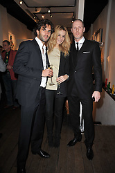 Left to right, JEROME ABOUCAYA, ANNA MacINTOSH and JEAN-DAVID MALAT at a collective exhibition of work entitles Bling Bling held at Opera Gallery, 134 New Bond Street, London on 15th December 2010.  Proceeds from the evening were raised for The Prince's Foundation for Children & the Arts.