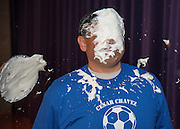 Chavez High School principal Rene Sanchez reacts after getting a pie in face during a rally for STAAR, March 27, 2014.