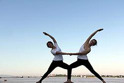 July 18, 2018 - Wuhu, Wuhu, China - Wuhu, CHINA-Women practice yoga by Yangtze River in Wuhu, east China's Anhui Province. (Credit Image: © SIPA Asia via ZUMA Wire)