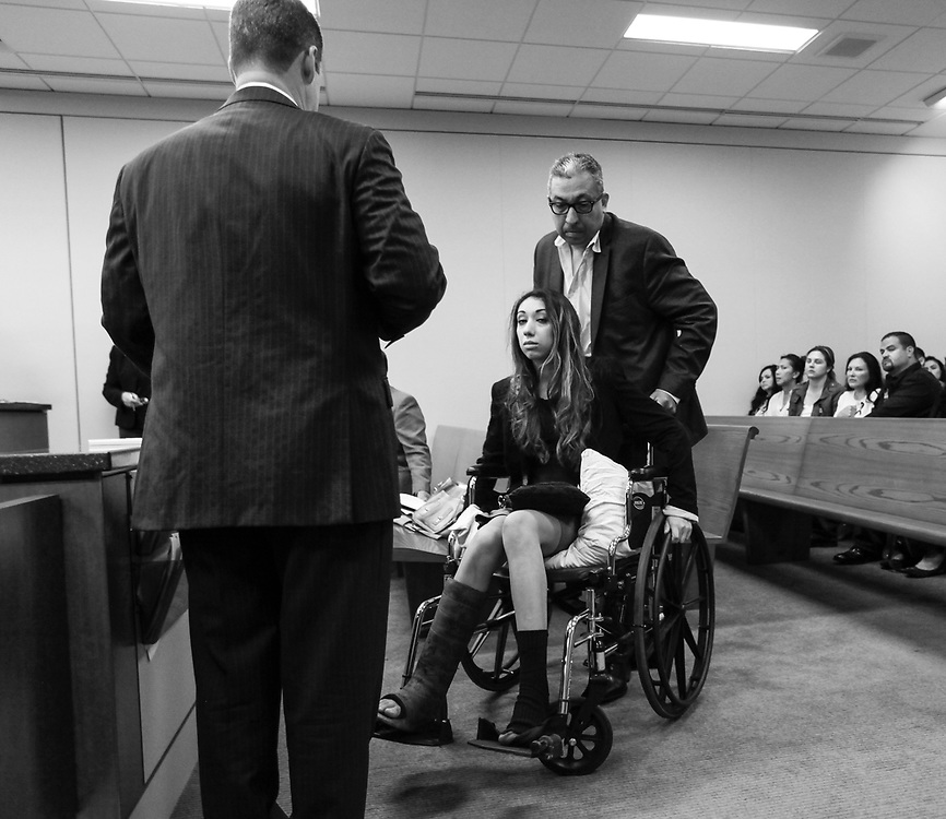 """Lynnea Hernandez is wheeled out of Monterey County Superior Coury by her father on May 2, 2016 after pleading not guilty to two counts of vehicular manslaughter with gross negligence and two counts of reckless driving causing injury to her passengers. <br /> <br /> Hernandez and six friends, who were on spring break from UC Santa Cruz, were driving to Big Sur,for a few days. Hernandez was driving her Lexus SUV heading south on Highway 1, the friends were seen on Snapchat singing, dancing in their seats and passing a marijuana pipe around in the car, according to the Monterey County District Attorney's Office. At one point, according to the DA, Hernandez was seen looking straight into the camera, taking her eyes off the road. Lillian Scott, a friend of Hernandez's, was seated in the middle back seat of the SUV. Scott was also killed in the crash. Other passengers in Hernandez's vehicle (including Hernandez herself) sustained major injuries. <br /> <br /> In January 2018, Hernandez pleaded guilty to two counts of vehicular manslaughter with gross negligence for each person killed and two counts of reckless driving causing injury to her passengers. She was sentenced on March 23, 2018 to six years in state prison.<br /> <br /> """"I gave him his first breath and she took away his last,"""" Veronica Ramirez said through tears while addressing Judge Julie Culver inside Monterey County Superior Court during Hernandez' sentencing in 2018."""