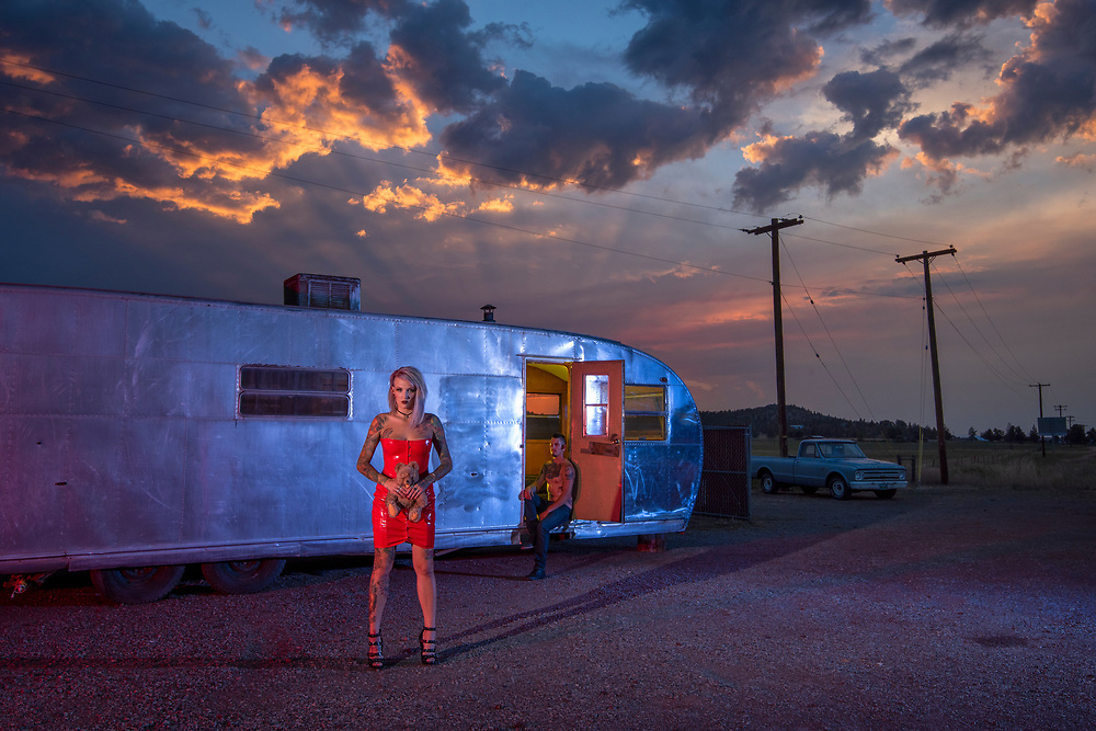 USA,Oregon, Redmond, Trailer and tattooed woman along highway 97 MR
