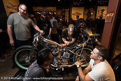 Kevin Dunworth, Jeremy Cupp, Tim Harney and Keino Sasaki give a close scrutiny to Jeremy's fascinating Buell-Ducati during the Friday night opening of the Handbuilt Motorcycle Show. Austin, TX. April 10, 2015.  Photography ©2015 Michael Lichter.