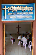 KHMER ROUGE CHRISTIANS. South East Asia, Cambodia, Pailin. Several high ranking ex Khmer Rouge officials including the notorious former Khmer Rouge prison chief Kaing Khek Lev, also known as Duch, have sympathies towards Christianity and Evangelism. Some have changed religion or even become Evangelist priests and pasteurs. Ex-Khmer Rouge buddhists have something to fear: Buddhism offers neither redemption or forgiveness; the Karma and the next life are affected by the present one. On the other hand, Christianity and Evangelism allow one to be born again, it forgives our sins and offers redemption. This proposition is far more attractive to those who orchestrated, organised and carried out mass murder, and torture on a grand scale, against the Cambodian people, leaving 2 million dead in the 1970's. American priests are working in Khmer Rouge strongholds, bringing their Evanglist message, and are having some success. Approved rules for UN-backed Khmer Rouge genocide trials are now in place. The highest ranking Duch is in prison, in Phnom Penh, ready to be tried. What role the Evangelists will play in this scenario is yet to be seen.///American christian priest with ex-Khmer Rouge Evangelist pasteurs