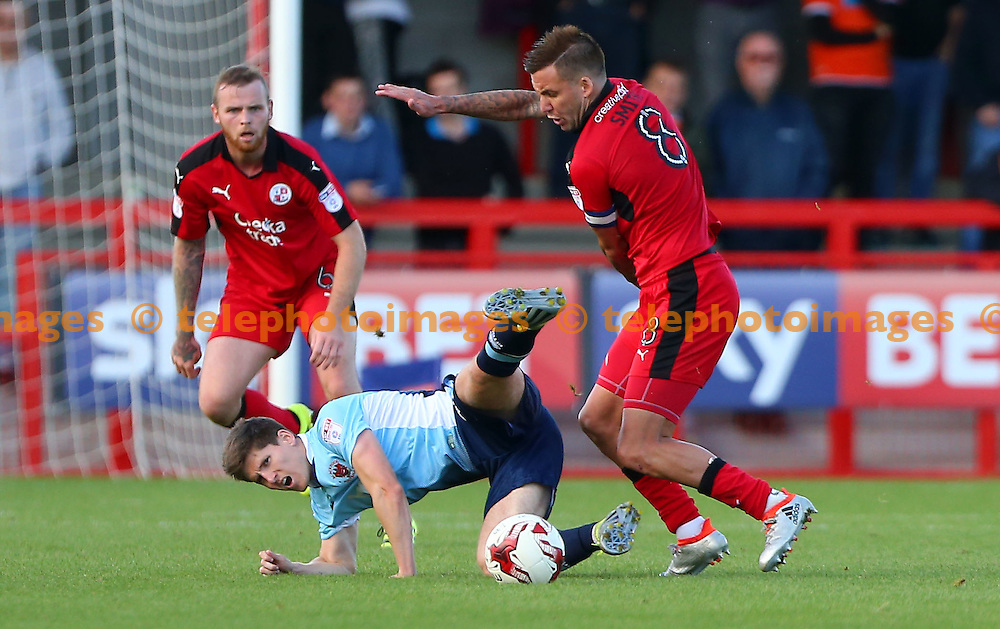 Crawley's Captain Jimmy Smith tackles Daniel Philliskirk of Blackpool during the Sky Bet League 2 match between Crawley Town and Blackpool at the Checkatrade Stadium in Crawley. October 1, 2016.<br /> James Boardman / Telephoto Images<br /> +44 7967 642437