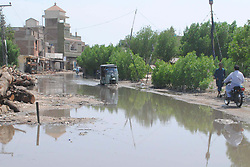 July 21, 2017 - Pakistan - HYDERABAD, PAKISTAN, JUL 21: Stagnant sewerage water on roads showing negligence of .concerned authorities at Station Road and it is also causing troubles for commuters, in .Hyderabad on Friday, July 21, 2017. (Credit Image: © PPI via ZUMA Wire)