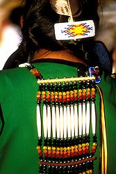Stock photo of the back of an American Indian woman in costume at the Taos Pueblo Pow Wow