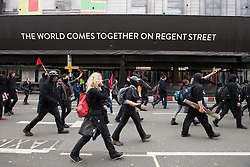 "© Licensed to London News Pictures . 20/10/2012 . London , UK . Black Bloc protesters break away from the main march and march along Regent Street . The TUC march in London against austerity and cuts , under the banner "" March for a future that works "" . Photo credit : Joel Goodman/LNP"