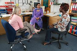 Women in office meeting.
