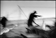 A salmon netter using a short stick to kill a salmon which has been caught using a 'jumper' net on the sands at  Kinnaber, Angus.<br /> Ref. Catching the Tide 48/00/16 (1st August 2000)<br /> <br /> The once-thriving Scottish salmon netting industry fell into decline in the 1970s and 1980s when the numbers of fish caught reduced due to environmental and economic reasons. In 2016, a three-year ban was imposed by the Scottish Government on the advice of scientists to try to boost dwindling stocks which anglers and conservationists blamed on netsmen.