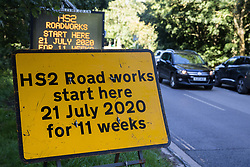 Great Missenden, UK. 17th July, 2020. A sign indicating the start of works for the HS2 high-speed rail link. Environmental activists from groups including Stop HS2 and HS2 Rebellion continue to protest nearby against HS2, which is currently projected to cost £106bn and which will remain a net contributor to CO2 emissions during its projected 120-year lifespan, on environmental and economic grounds.