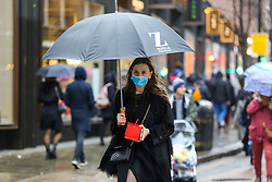 © Licensed to London News Pictures. 26/01/2020. London, UK.  A woman in central London is seen wearing a face mask following the outbreak of Coronavirus in China which has killed 41 people. Photo credit: Dinendra Haria/LNP