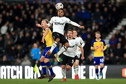 Southampton's James Ward-Prowse (left) and Derby County's Duane Holmes battle for the ball during the Emirates FA Cup, third round match at Pride Park, Derby.