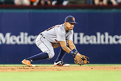 May 8, 2018 - Arlington, TX, U.S. - ARLINGTON, TX - MAY 08: Detroit Tigers shortstop Dixon Machado (49) fields the baseball during the game between the Texas Rangers and the Detroit Tigers on May 08, 2018 at Globe Life Park in Arlington, Texas. Detroit defeats Texas 7-4. (Photo by Matthew Pearce/Icon Sportswire) (Credit Image: © Matthew Pearce/Icon SMI via ZUMA Press)
