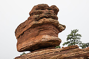 Balanced Rock. Garden of the Gods National Natural Landmark is run by the City of Colorado Springs in Colorado, USA. The park's outstanding geologic features of are ancient sedimentary beds of red, pink and white sandstones, conglomerates and limestone that were deposited horizontally, but have now been tilted vertically and faulted into fins by forces during uplift of the Rocky Mountains and Pikes Peak massif.