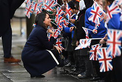 Meghan Markle meets members of the public on a walkabout with Prince Harry during a visit to Millennium Point in Birmingham, as part of the latest leg in the regional tours the couple are undertaking in the run-up to their May wedding.