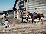 Nevada City historic ghost town, Montana, USA video crew filming two cowboys on horses