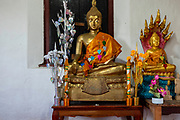 Sitting Buddha statues in the small temple atop  Mount Phousi, Luang Prabang, Laos.