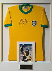 "© Licensed to London News Pictures. 01/06/2016. Pele World Cup winners Number ""10"" signed jersey display with an estimate of £1,400-£2-100 from the Pele: The Collection with over 1,500 items of memorabilia owned by Pele for sale on later in June. London, UK. Photo credit: Ray Tang/LNP"