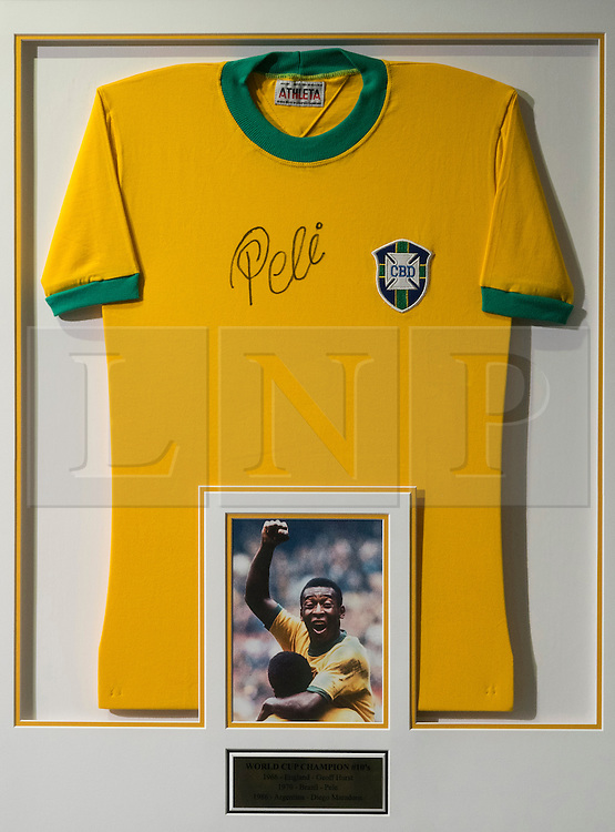 """© Licensed to London News Pictures. 01/06/2016. Pele World Cup winners Number """"10"""" signed jersey display with an estimate of £1,400-£2-100 from the Pele: The Collection with over 1,500 items of memorabilia owned by Pele for sale on later in June. London, UK. Photo credit: Ray Tang/LNP"""