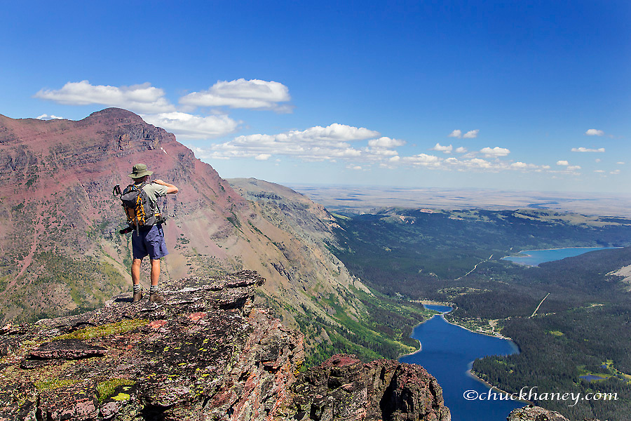 John Opatz looking down onto Two Medicine Lake from the Diving Board on Sinopah Mountain in Glacier National Park, Montana, USA