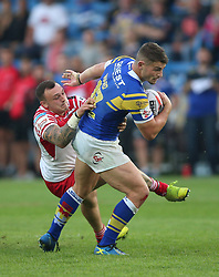 Leeds Rhinos Steveie Ward is tackled by Leigh Centurions Matty Dawson during the Ladbrokes Challenge Cup, quarter final match at the LD Nutrition Stadium, Featherstone.