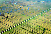 Nederland, Zuid-Holland, Hoeksche Waard, 01-04-2016; Polder het Oudeland van Strijen, Molenweg met hoogspanningslijn en de waterloop Dwarsche Vaart.<br /> <br /> Polder, old land, south of Rotterdam.<br /> <br /> luchtfoto (toeslag op standard tarieven);<br /> aerial photo (additional fee required);<br /> copyright foto/photo Siebe Swart