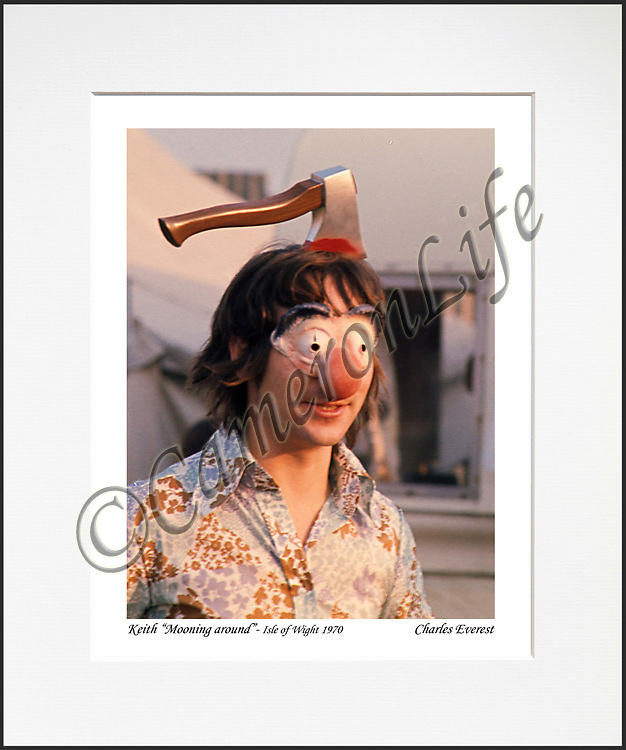 """Keith Moon - An affordable archival quality matted print ready for framing at home.<br /> Ideal as a gift or for collectors to cherish, printed on Fuji Crystal Archive photographic paper set in a neutral mat (all mounting materials are acid free conservation grade). <br /> The image (approx 6""""x8"""") sits within a titled border. The outer dimensions of the mat are approx 10""""x12"""""""