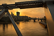 Skyline of the city of London and Tower Bridge taken from the Millenium Bridge at dawn during the coronavirus pandemic on the 24th April 2020 in London, United Kingdom.