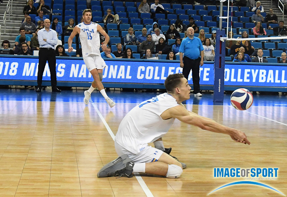 UCLA Bruins opposite hitter Christian Hessenauer (17) digs the ball against the Harvard Crimson during the opening round game of the NCAA college volleyball championship in Los Angeles, Tuesday, May 1, 2018. UCLA defeated Harvard 23-25, 25-21, 25-11, 25-21.
