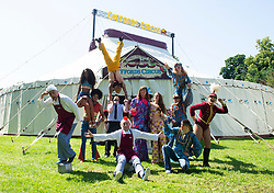 """Giffords Circus presents """"Xanadu"""" <br /> Produced by Nell Gifford  - Directed by Cal McCrystal<br /> At Chisiwck House and Park, London, Great Britain <br /> Press view <br /> 27th June 2019 <br /> <br />  l-r <br /> <br /> Big Group: Jan Erik Brenner, Iovany Sanchez Guerrero, Dayana Rendo Belet (on shoulders), Giuseppe Curatola (in blue holding) Emanuel Curatola, Tweedy (clown in front) Michael Fletcher (in sparkly suit) Lil Rice (in yellow) Tony Donnert holding Emilia Sandulescu, Alfons Donnert in Front, Camille Smith (in feathered hat)<br /> <br /> <br /> *<br /> <br /> Girls and balancers<br /> Left to right in front of wigs wagon<br /> Finley Guy, Camille Smith, Dayana & Iovany, Eliza Wimperis and Constance Ramsey <br /> <br /> *<br /> <br /> The Donnert Family <br /> Left to Right <br /> Arnold holding horse, Emilia Sandulescu, Alfons and Tony Donnert <br /> <br /> *<br /> <br /> Clowns/flour<br /> Jan Erik Brenner & Tweedy<br /> <br /> Roll up, roll in to the stately pleasure-dome for miracles, song, symphony and enchantment. Musicians, horses, clowns and tumblers enfolded in this joyful paradise, with music loud and long - the Giffords Circus caravan will be taking to the road for a 2019 summer of love.<br /> <br /> <br /> It is midsummer 1973 in Hyde Park and the flower power movement is at its height. Hippies, hipsters, rock stars, musicians, wild women and global nomads with Shamanic horses gather to play, sing, dance, protest and perform. Policemen and a family of out-of-towners get caught up in the celebrations. Will they get in the groove? Nell Gifford builds a pleasure dome and Tweedy has a job in the kitchen as he thought everyone was talking about """"Flour Power"""". As evening approaches, the ever more chaotic event careers towards a joyful, transcendental finale. <br /> <br /> Photograph by Elliott Franks"""
