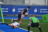 Rugby Union - 2021 U20 Six Nations - Round Two - England vs Scotland - Cardiff Arms <br /> <br /> Scott King Scotland Under 20s escapes the tackle of Dan Lancaster England Under 20s to score in the corner , watched by the touch judge in the final move of the game<br /> <br /> COLORSPORT/WINSTON BYNORTH