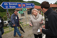 The Minister for the Environment being interviewed by The Guardian, outside the Armenis Bison Centre, Release of European bison, Bison bonasus, in the Tarcu mountains nature reserve, Natura 2000 area, Southern Carpathians, Romania. The release was actioned by Rewilding Europe and WWF Romania in May 2014.