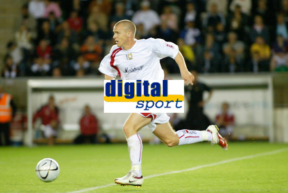 Photo: Marc Atkins.<br /> Milton Keynes Dons v Colchester United. Carling Cup. 22/08/2006.Mk Dons's John Paul McGovern
