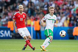 PARIS, FRANCE - Saturday, June 25, 2016: Wales' Aaron Ramsey in action against Northern Ireland's Steven Davis during the Round of 16 UEFA Euro 2016 Championship match at the Parc des Princes. (Pic by Paul Greenwood/Propaganda)
