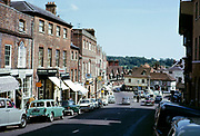 Cars and shops in town centre of Arundel, West Sussex, England.1965