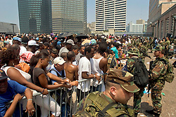 2nd Sept, 2005. New Orleans, Louisiana.<br /> Day 2 of the mass exodus. Thousands of people wait in the baking sun for  evacuation from the hellish Superdome.<br /> Photo Credit; Charlie Varley/varleypix.com