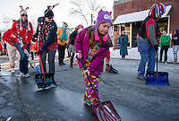 Members of the Snow Shovel Bridage bring smiles as they march down the parade route through downtown Laconia on Saturday afternoon.  (Karen Bobotas/for the Laconia Daily Sun)