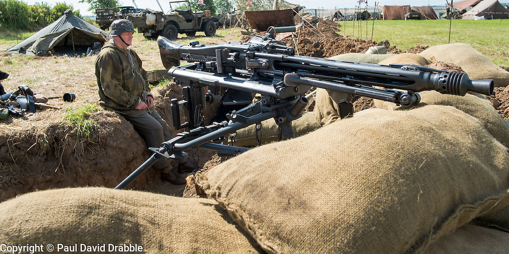 MG42 of the Panzer Grenadier Division Großdeutschland faces out from the Living History trench<br />  17 July 2016<br />  Copyright Paul David Drabble<br />  www.pauldaviddrabble.photoshelter.com