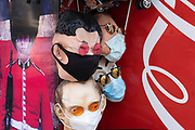 Masks of various World leaders wearing face masks and sunglasses including North Korean premier Kim Jong-un, as some non-essential shops re-open, shoppers return to Oxford Street while social distancing measures are put in place by the various retail shops which are open on 26th June 2020 in London, England, United Kingdom. As the July deadline approaces and government will relax its lockdown rules further, the West End remains quiet, apart from this popular shopping district, which itself has far fewer people on its pavements than normal.