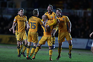 Sean Rigg of Newport county © celebrates with his teammates after he scores his teams 1st goal to equalise at 1-1.  EFL Skybet football league two match, Newport county v Luton Town at Rodney Parade in Newport, South Wales on Tuesday 21st March 2017.<br /> pic by Andrew Orchard,  Andrew Orchard sports photography.