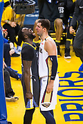 Golden State Warriors forward Draymond Green (23) celebrates a dunk in the face of New Orleans Pelicans forward Nikola Mirotic (3) at Oracle Arena during Game 2 of the Western Semifinals in Oakland, California, on May 1, 2018. (Stan Olszewski/Special to S.F. Examiner)