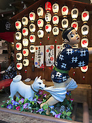 The famous Okonomiyaki restaurant, Issen Yoshoku, in Gion, Kyoto, Japan, with its trademark sign of a dog chasing a boy thief and biting his trousers