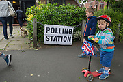 Children on their way to school on the morning of the UK 2017 general elections outside the polling station at St. Barnabas Parish Hall in Dulwich Village  on 8th June 2017, in London, England.
