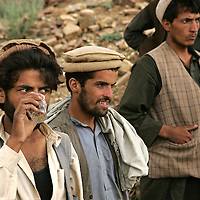 .20th August 2007.Tora Bora.A group of young men whose families have recently returned to the area sit and chat and drink tea at Tora Bora on the 20th August 2007. Tora Bora was one of the mountain hideouts of Osama Bin Laden and the Al-Qaeda fighters. It was destroyed during the battle of Tora Bora at the beginning of this recent conflict.  In the past weeks it has been the scene of a joint US and Afghan offensive against Taliban fighters who have moved back into the area....
