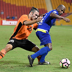 BRISBANE, AUSTRALIA - JANUARY 31: Serge Kaole of Global FC and Nicholas D'Agostino of the Roar compete for the ball during the second qualifying round of the Asian Champions League match between the Brisbane Roar and Global FC at Suncorp Stadium on January 31, 2017 in Brisbane, Australia. (Photo by Patrick Kearney/Brisbane Roar)
